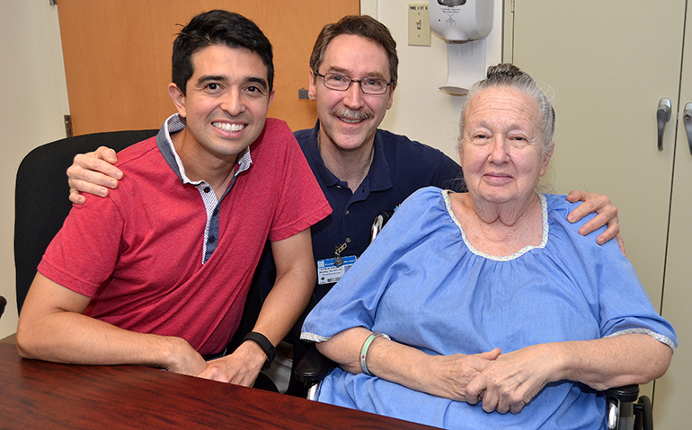 Physical therapist assistant Randal Koerner, center, buddies up with two patients at St. Catherine's Rehabilitation Hospital in North Miami. From left are Fernando Pacheco and Judy Winters.