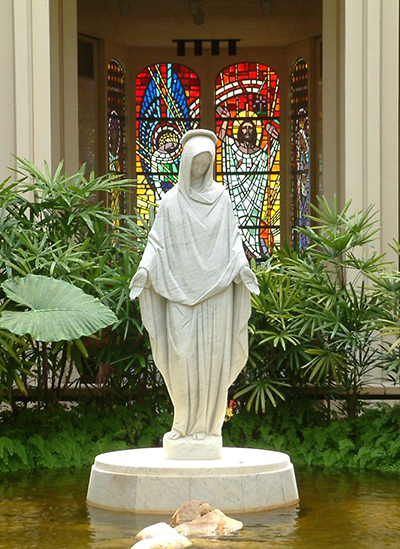 This statue of Our Lady of Mercy welcomes visitors to the chapel at Our Lady of Mercy Cemetery in Miami. Catholic Cemeteries of the Archdiocese of Miami embody the words of the new Vatican document by providing a dignified burial place and