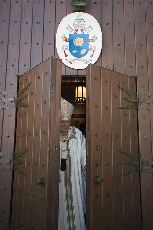 Archbishop Thomas Wenski closes the Holy Door at St. Mary Cathedral after the Thanks-for-Giving Mass Nov. 20, feast of Christ the King and closing day of the Jubilee Year of Mercy.