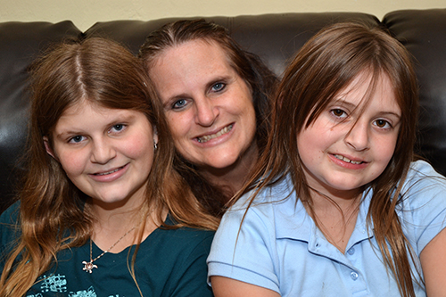 Kimberly Eisenmann-Byerly of Plantation, with her children Daley, 13, left, and Kailey, 7. Both children have gone to Camp Erin, a bereavement camp run by Catholic Hospice, a ministry of the archdiocese.