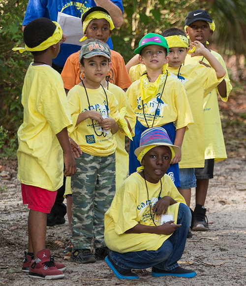 Campers prepare for a nature walk at Camp Erin.