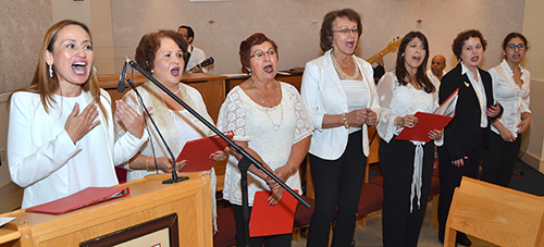 Choir from Our Lady of the Lakes Parish, Miami Lakes, sings at the 70th anniversary Mass for St. Thomas University.