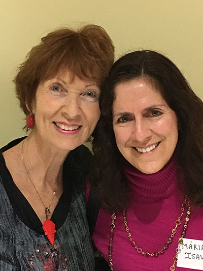 Dolores Hanley McDiarmid, left, poses after her book signing with Maria Isava from Mary Help of Christians Parish in Parkland. They attended St. Thomas University's Pastoral Ministries Program together.