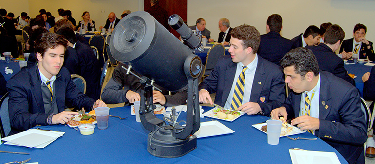 A small telescope was among the table centerpieces for a luncheon at the Belen Jesuit Preparatory School during a visit by Brother Guy Joseph Consolmagno, director of the Vatican Observatory.