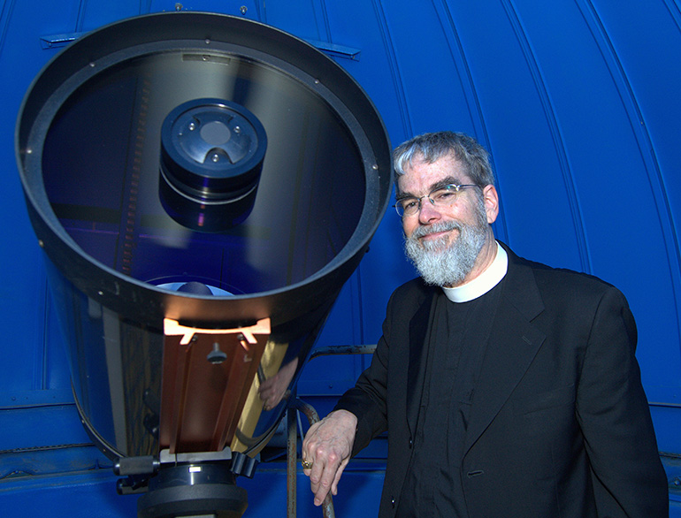 Brother Guy Joseph Consolmagno, director of the Vatican Observatory, poses with the 16-inch telescope of Belen Jesuit Preparatory School.