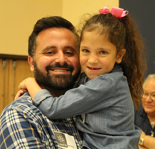 Daddy's girl: Demi Espinosa embraces her father, Daniel Espinosa, during the God's Perfect Design retreat.