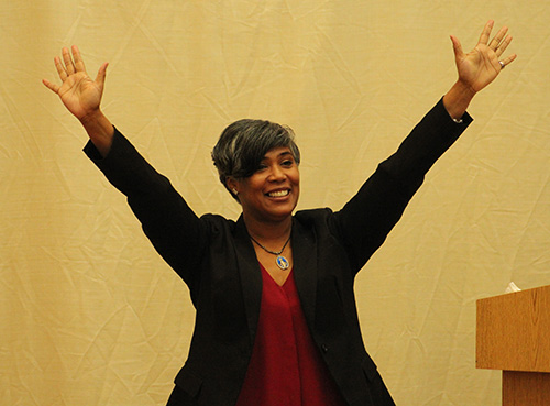 Lydia Ocasio-Stoutenburg, speaker and organizer of God's Perfect Design retreat, raises her hands imitating her son's praise when he saw the image of Our Lady of Perpetual Help.