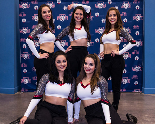 Victoria Molina, standing at center, poses with her St. Thomas University dance teammates. She gave up being the team co-captain because of the time she needed to be away for Irish step dancing competitions.
