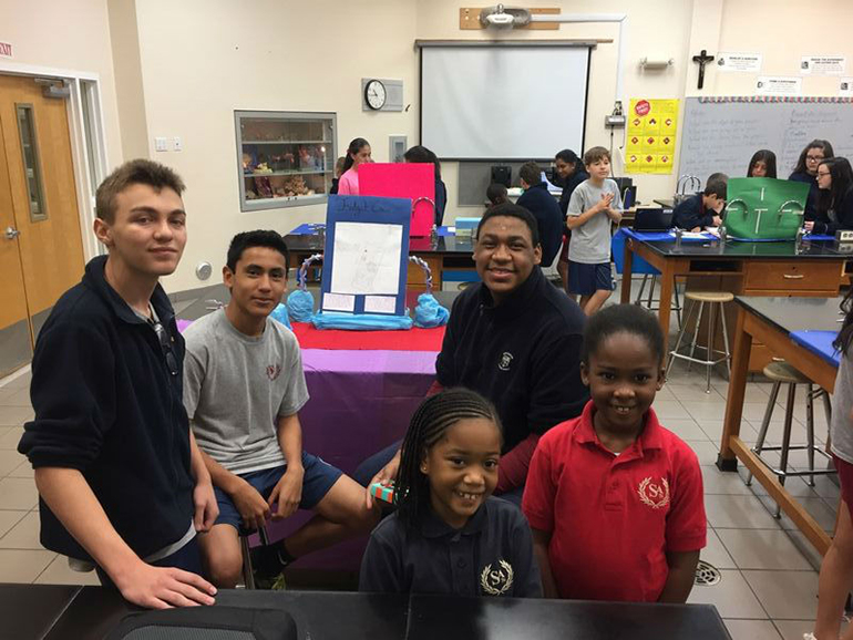 St. Andrew School eighth-graders present their engineering project to the school's third graders during the school's first Celebrate Engineering Fair.