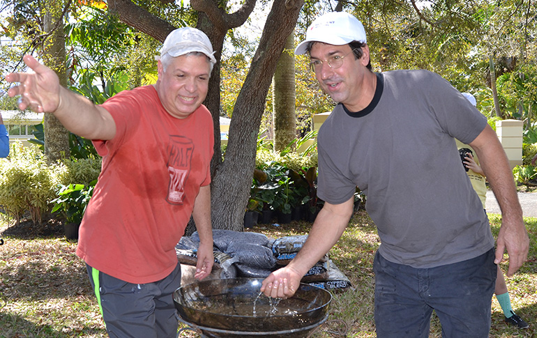 Michael DeFerrari, left, and Tony Buzone bless the ground of the new Prayer Labyrinth.