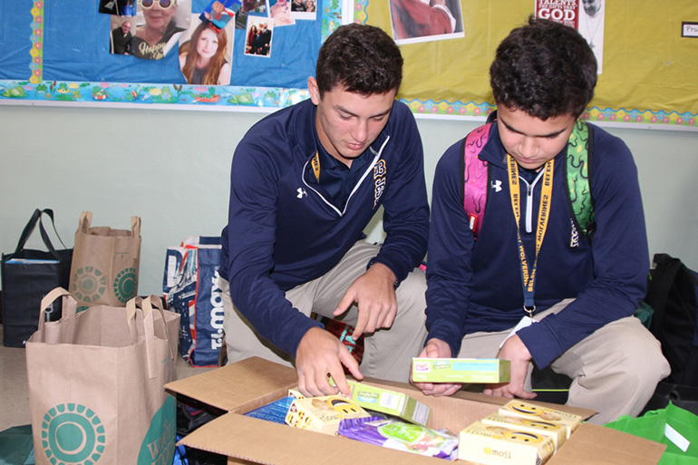 Belen Jesuit's seventh graders assemble care packages for the homeless which will be distributed to the Missionaries of Charity.