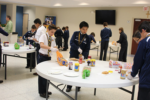 Belen Jesuit Prep's sixth graders make sunflower seed butter and jelly sandwiches for the homeless of Camillus House and the Missionaries of Charity during the culmination of Ignatian Week March 17.