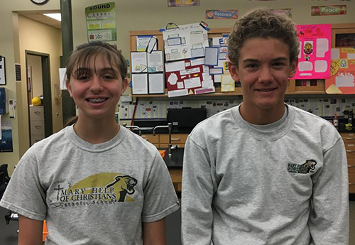 Sixth graders Victoria Servideo, left, and Rafael Opperman won fourth place and the Air Force Award, respectively, at this year's Broward regional science fair. They were two of the 10 entrants from Mary Help of Christians School in Parkland.