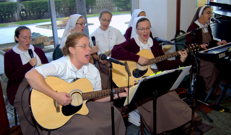 Members of the Servants of the Pierced Hearts of Jesus and Mary provided music during Mass at the recent Marriage Summit. Archbishop Wenski said the Mass in the chapel at Saint John Vianney College Seminary, Miami.