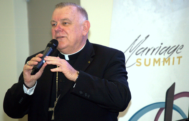Marriage is a vocation like the priesthood, Archbishop Wenski said at the Marriage Summit at St. Brendan High School in Miami.