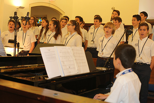 A student choir sings at the Mass for 90th anniversary of St. Anthony School, April 3 in Fort Lauderdale.