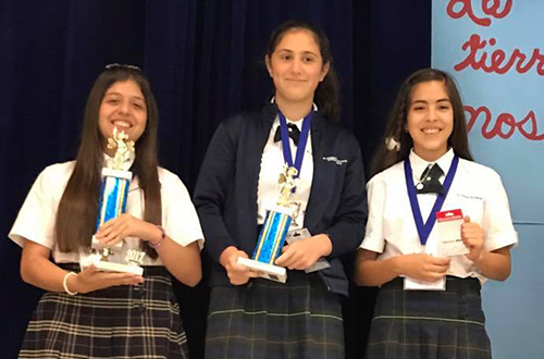 Andrea Schroeder, left, an eight grader at St. Andrew School in Coral Springs, is the repeat winner of the fourth annual Archdiocese of Miami Spanish Spelling Bee. The second and third place winners were Camila Suels and Ana Serratos, both of St. Thomas the Apostle School in Miami.