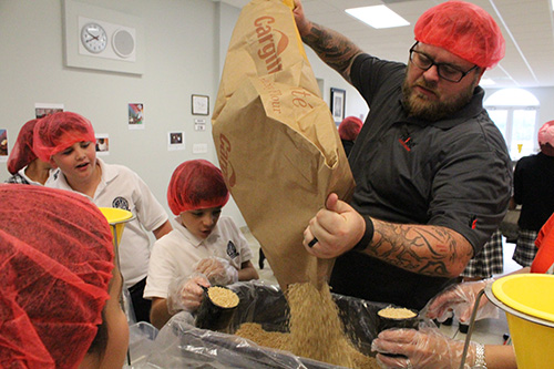 Make way for the protein: Jason Haulbrook refills a box of dried soy flour that will be mixed into the meal bags.