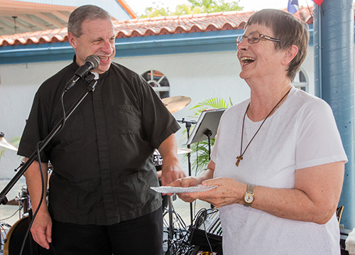 Msgr. Pablo Navarro shares a laugh with Franciscan Sister Ann McDermott, the third director of the Office of Lay Ministry, who received a token of recognition for her years of service.