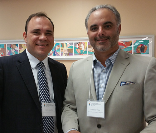 Eddy Augsten, left, and Gus Vega, of Vega and Oprandi Wealth Partners, were among the more than 100 tax, wealth management and accounting professionals who attended the first Legacy Planning Summit hosted by the Archdiocese of Miami's Development Office.