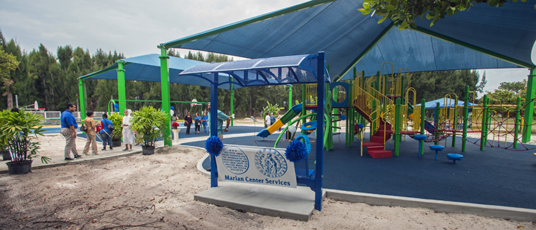 View of the new Sister Lucia Sport and Fitness Park at the Marian Center, which includes a play structure for climbing and sliding, swings, and a renovated basketball court.