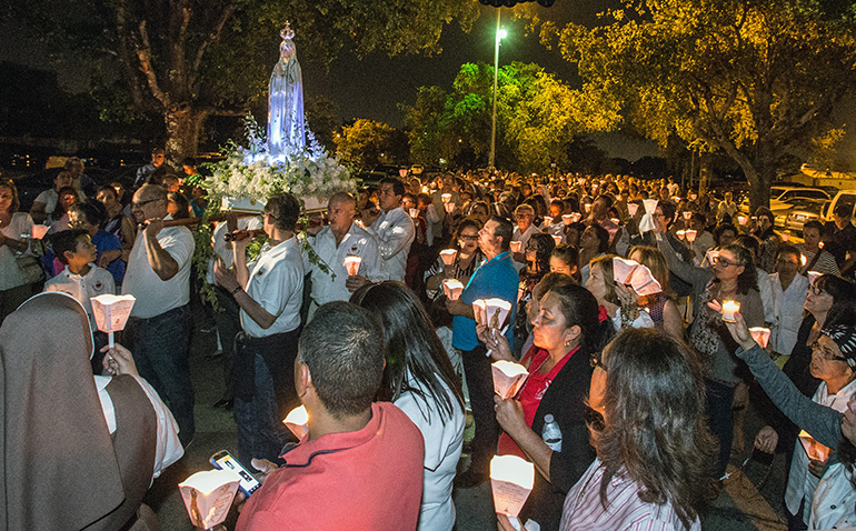A statue of Our Lady of Fatima is carried around St. Michael Church during the candlelight procession May 13.