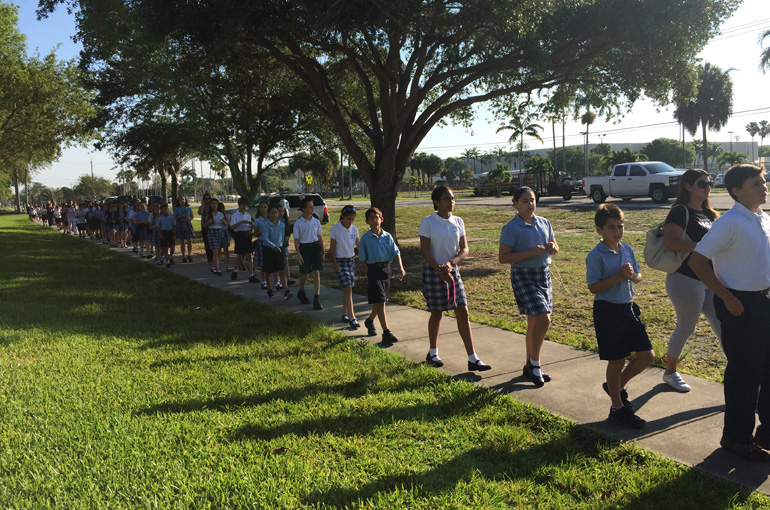 Students from St. Bonaventure School walk and pray during a procession in honor of the Virgin Mary.
