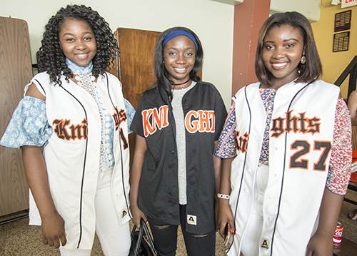 From left: Christie Etienne, Maniola Mompremier and Dominique Etienne. Christie will finish her senior year at Msgr. Edward Pace High School; Mompremier and Dominique Etienne are 2015 grads of Archbishop Curley Notre Dame.