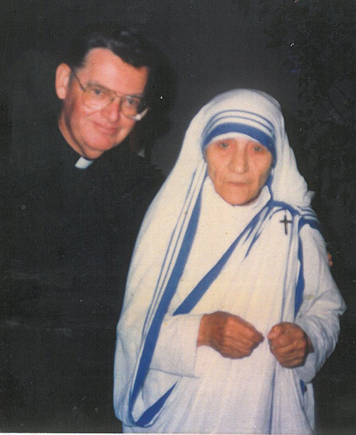 Father John McLaughlin poses with Mother Teresa during her visit to St. Martha Church in 1986.