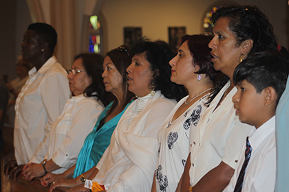 Members of Women Working Together USA take part in the Mass celebrated by Archbishop Thomas Wenski in honor of domestic workers.