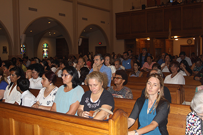 Dozens of domestic workers, along with representatives of labor groups working on their behalf, attended the Mass celebrated by Archbishop Thomas Wenski in their honor.