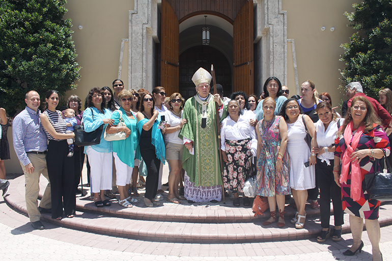 Domestic workers and labor representatives pose with Archbishop Thomas Wenski after the Mass celebrated June 25 at St. Mary Cathedral to recognize domestic workers in Miami-Dade County.