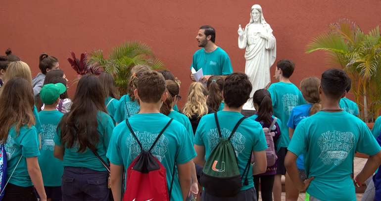 Jorge Santibanez speaks to the volunteers at St. Theresa School's Vacation Bible Camp.