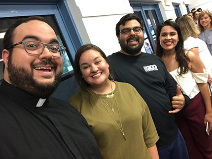 Encuentros Juveniles past and current coordinators pose for a photo. Among the leaders, from left to right, are Deacon Matthew Gomez, Annette Barroso, Alexander Gomez, and Rebecca Garcia, the current coordinator.