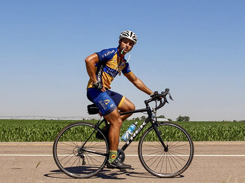 Matthew George pauses his ride to pose for a photo somewhere in Indiana near the end of July. He is part of a three-team, three-route Journey of Hope to raise funds and awareness this summer for a host of adult and youth disabilities, both mental and physical.