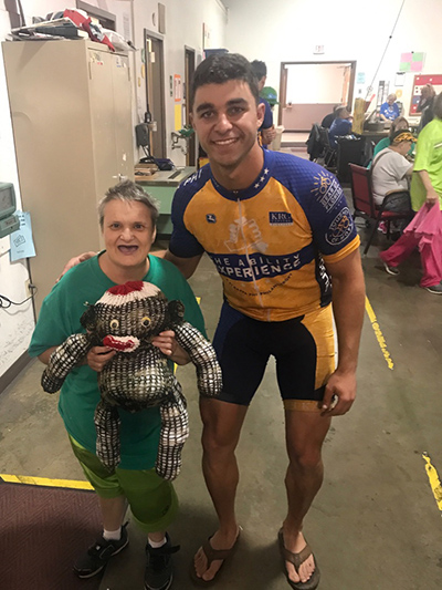 Matthew George poses with Brenda, one of the disabled adults he has met along his Journey of Hope ride from Seattle to Washington, D.C.