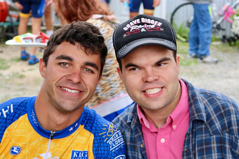 Matthew George poses with Tyler, one of the disabled adults he has met along his Journey of Hope ride from Seattle to Washington, D.C.