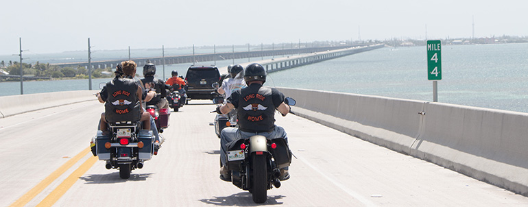 """Archbishop Thomas Wenski, Bear Woznick and his crew ride on the Seven Mile Bridge back to Miami from Key West. The ride will be featured in the second season of Woznick's """"Long Ride Home"""" reality series on EWTN."""