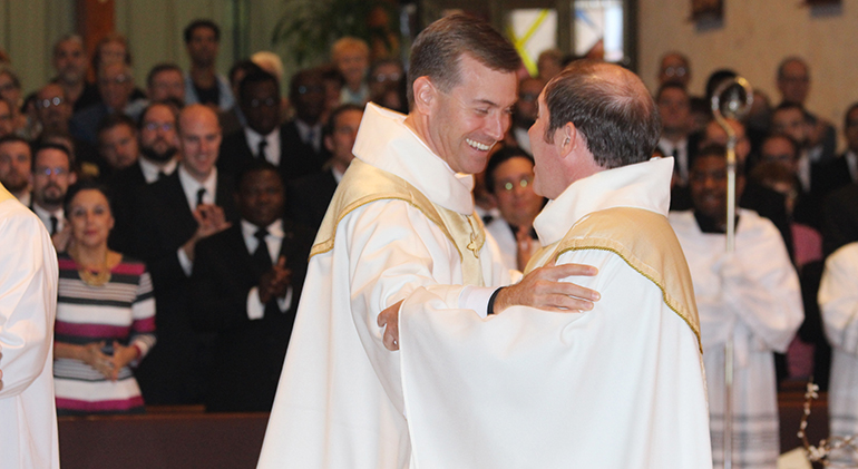 Msgr. David Toups, rector of St. Vincent de Paul Regional Seminary in Boynton Beach, congratulates Father Martin Dunne III moments after he becomes a new priest of the Diocese of Palm Beach. Father Dunne spent years in study, formation and discernment at the seminary in preparation for the priesthood.