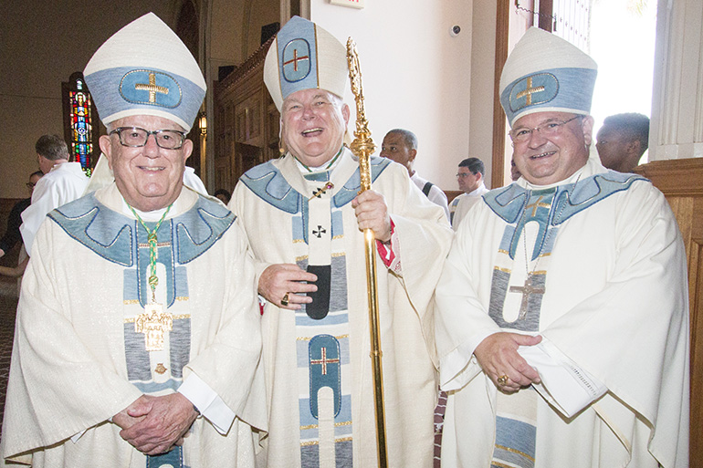Archbishop Thomas Wenski poses with his predecessor, at left, Archbishop Emeritus John C. Favalora, who ordained him a bishop 20 years ago, and Auxiliary Bishop Peter Baldacchino, whom Archbishop Wenski ordained as bishop three years ago.