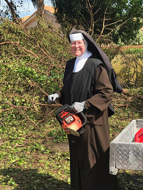 Sister Margaret Ann, a Carmelite of the Most Sacred Heart who serves as principal at Archbishop Coleman Carroll High School in West Kendall, became a social media sensation when an off-duty Miami-Dade police officer posted video and this photo of her wielding a chain saw to clear trees from a roadway.