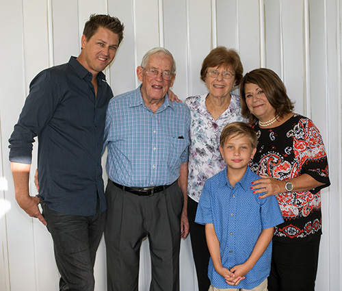 Margaret Barbick, far right, poses with former student Michael Longman ('82-'83), far left, his parents, Bob Longman and Susan Longman, and Tristan Longman, 9, whom she taught her last year at St. Rose of Lima School. Bob and Susan had 12 children: Barbick taught seven of them and also taught seven of their grandchildren.