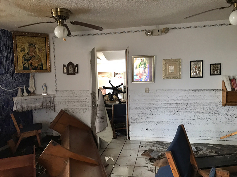 View inside the church of St. Peter the Fisherman in Big Pine Key shows the water mark on the walls, but the images of the Virgin Mary remained in place, seemingly untouched.