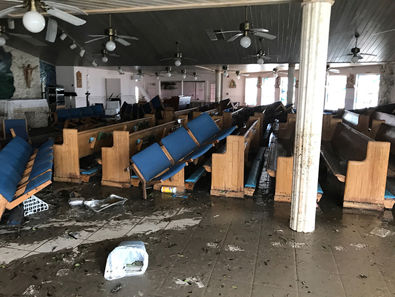 View inside the church of St. Peter the Fisherman in Big Pine Key shows the pews tossed by wind and water from Hurricane Irma. It was the archdiocesan facility most devastated by the storm's passage through South Florida. The church is now unusable and the parish remained without air conditioning, phone or internet as of Sept. 20. Parochial administrator Father Jesus