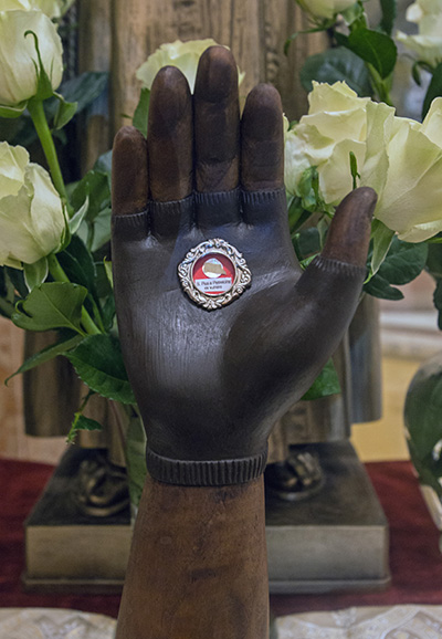 Those who attended the annual Padre Pio Mass at St. Mary Cathedral also venerated this first-class relic of the saint's garment stained with blood from his stigmata.