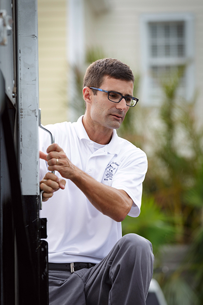 Robert Wright, principal of the Basilica School of St. Mary Star of the Sea in Key West, watches as volunteers from the Archdiocese of Miami deliver emergency supplies Sept. 26. The donated items had been collected at a dozen Catholic schools and parishes in Miami following the storm and left at hard-hit sites from Key Largo to Key West.