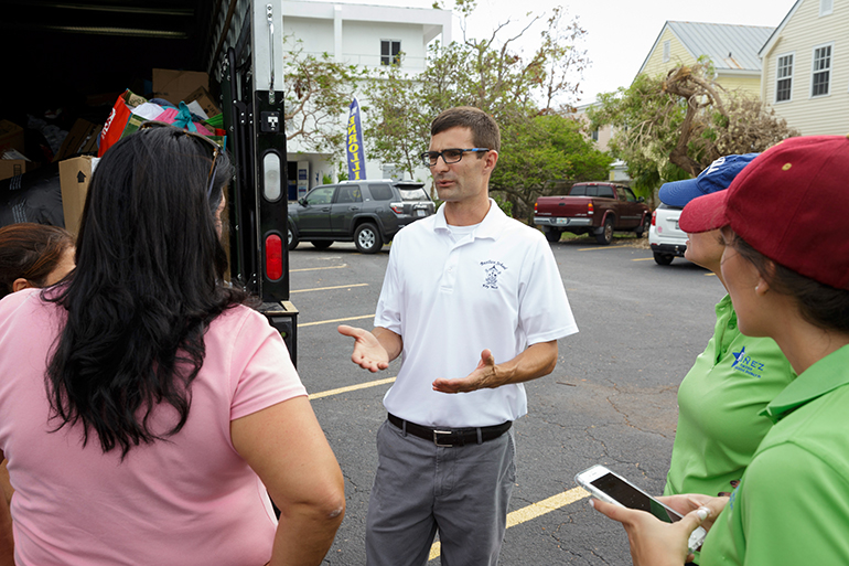 Robert Wright, principal of the Basilica School of St. Mary Star of the Sea in Key West, speaks with volunteers from the archdiocese who delivered a caravan of emergency supplies Sept. 26 to locations throughout the Florida Keys as that region recovers from Hurricane Irma. The donated items had been collected at a dozen Catholic schools and parishes in Miami following the storm and left at hard-hit sites from Key Largo to Key West.