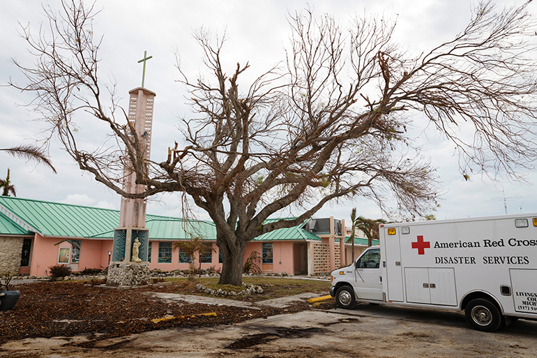 An American Red Cross vehicle is parked among the debris at the Miami archdiocesan church most devastated by Hurricane Irma, St. Peter the Fisherman in Big Pine Key. The church has been deemed unusable and is expected to be rebuilt.