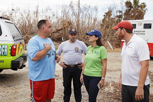 State Rep. Jeanette Nunez, a Miami Republican who chairs the House Select Committee on Hurricane Response and Preparedness in Florida, speaks with American Red Cross staff adjacent to the grounds of the Miami archdiocesan church most devastated by Hurricane Irma, St. Peter the Fisherman in Big Pine Key.