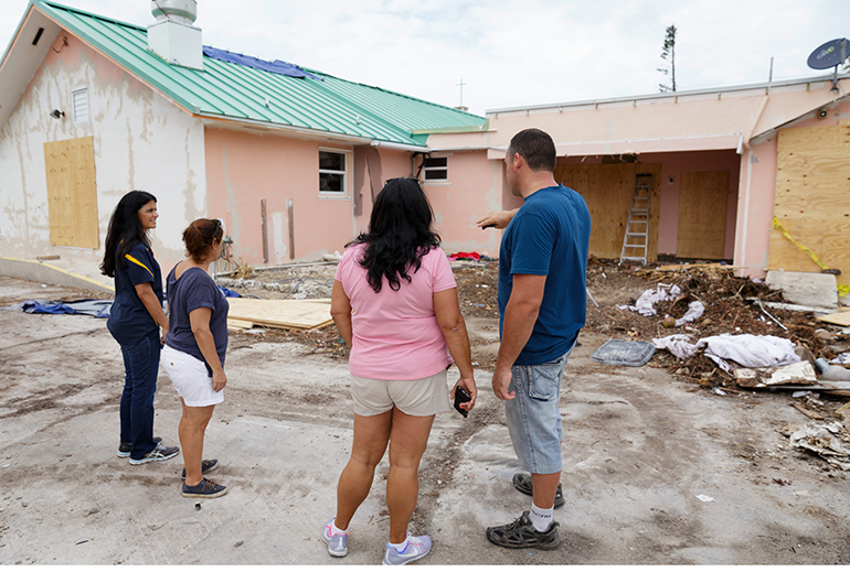 Volunteers from parishes throughout the Archdiocese of Miami inspect the grounds at the archdiocesan church most devastated by Hurricane Irma, St. Peter the Fisherman in Big Pine Key. The church has been deemed unusable and is expected to be rebuilt.